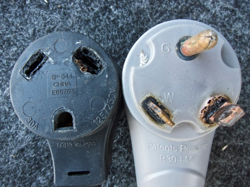 Damaged surge protector (left) and power cord (right)
