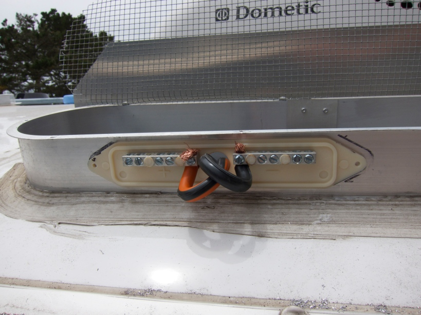 Rooftop junction box combines individual panel wires (10/2 awg) into a single heavy-guage wire (6/2 awg)